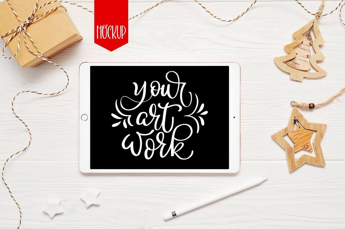 Download Free Christmas Ipad Mockup Graphic By Happy Letters Creative Fabrica for Cricut Explore, Silhouette and other cutting machines.