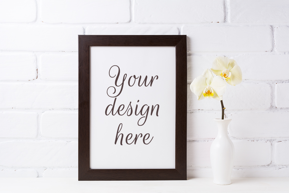 Print on Demand: Black Brown  Frame Mockup with Soft Yellow Orchid in Vase Graphic Product Mockups By TasiPas