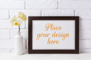 Print on Demand: Black Brown  Landscape Frame Mockup with Soft Yellow Orchid in Vase Graphic Product Mockups By TasiPas