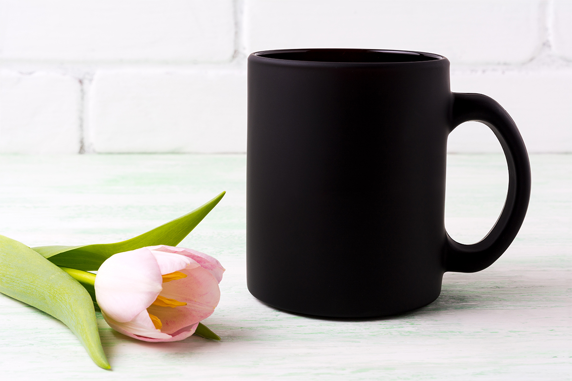 Download Free Black Coffee Mug Mockup With Pink Tulip Graphic By Tasipas for Cricut Explore, Silhouette and other cutting machines.