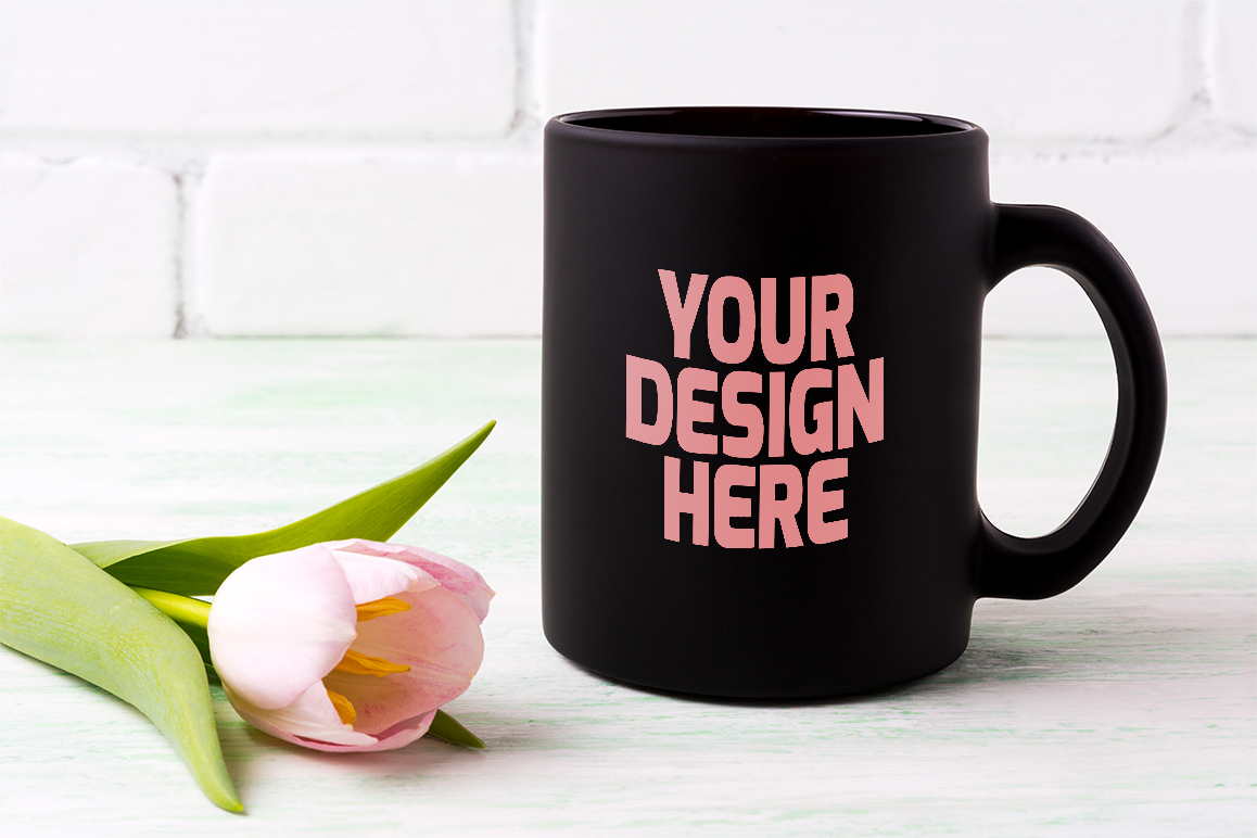 Print on Demand: Black Coffee Mug Mockup with  Pink Tulip Graphic Product Mockups By TasiPas