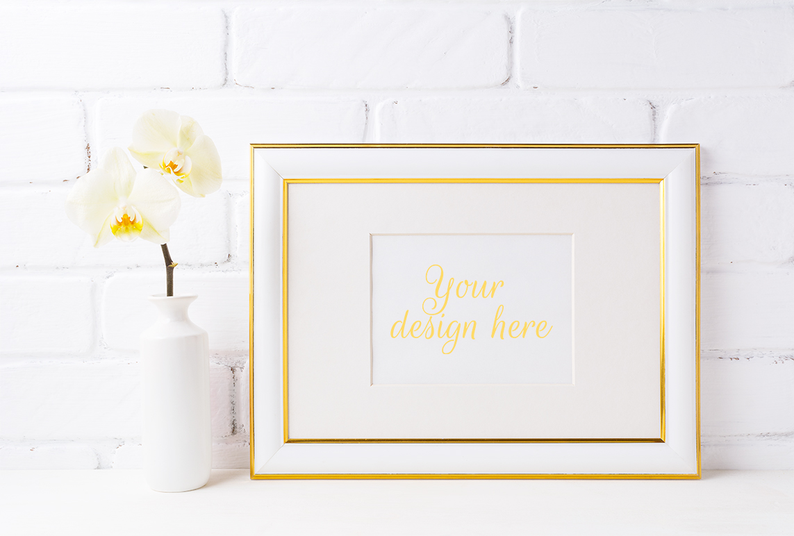 Print on Demand: Gold Decorated Landscape Frame Mockup with Soft Yellow Orchid in Vase Graphic Product Mockups By TasiPas