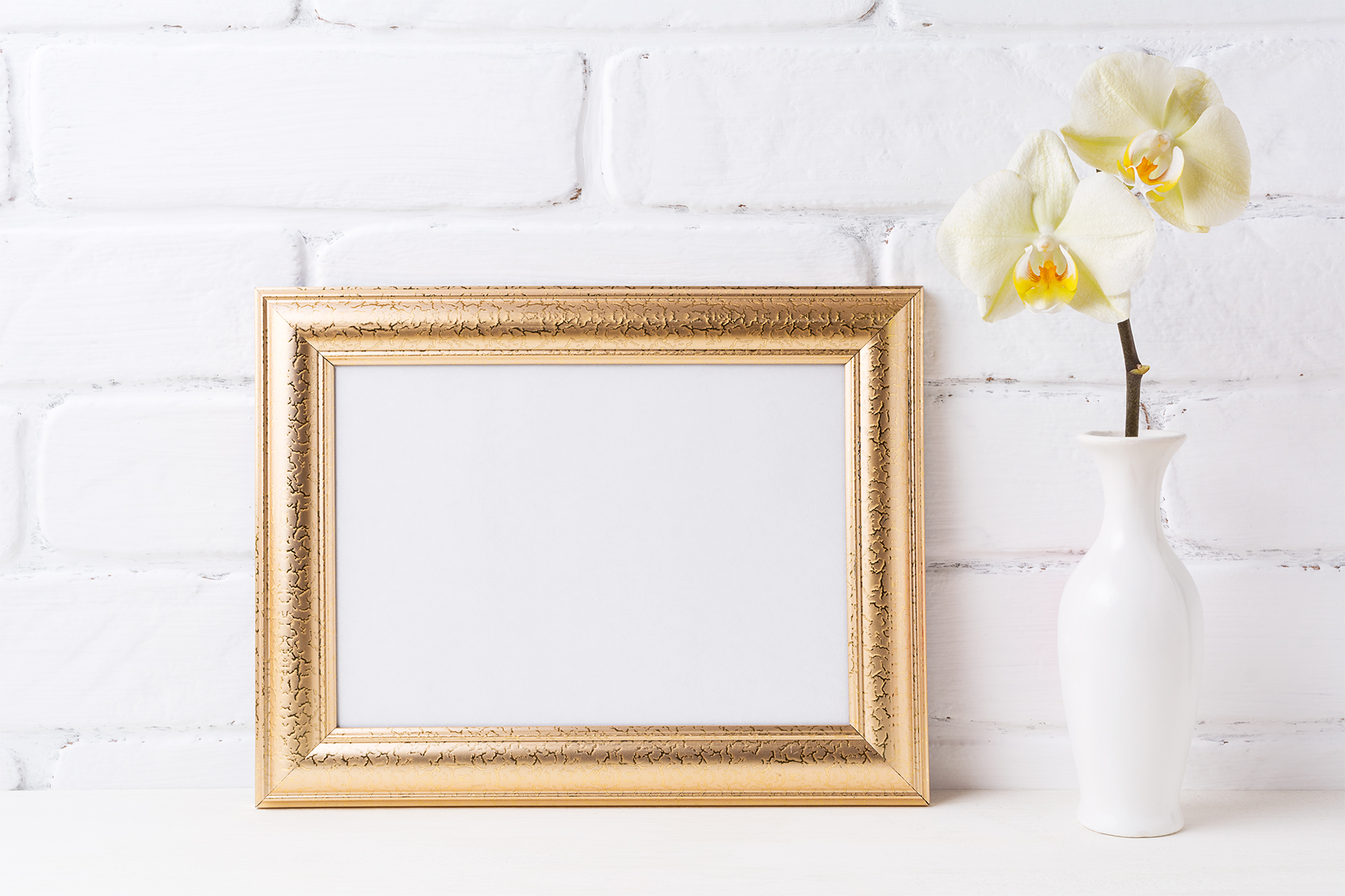 Download Free Golden Landscape Frame Mockup With Soft Yellow Orchid In Vase for Cricut Explore, Silhouette and other cutting machines.