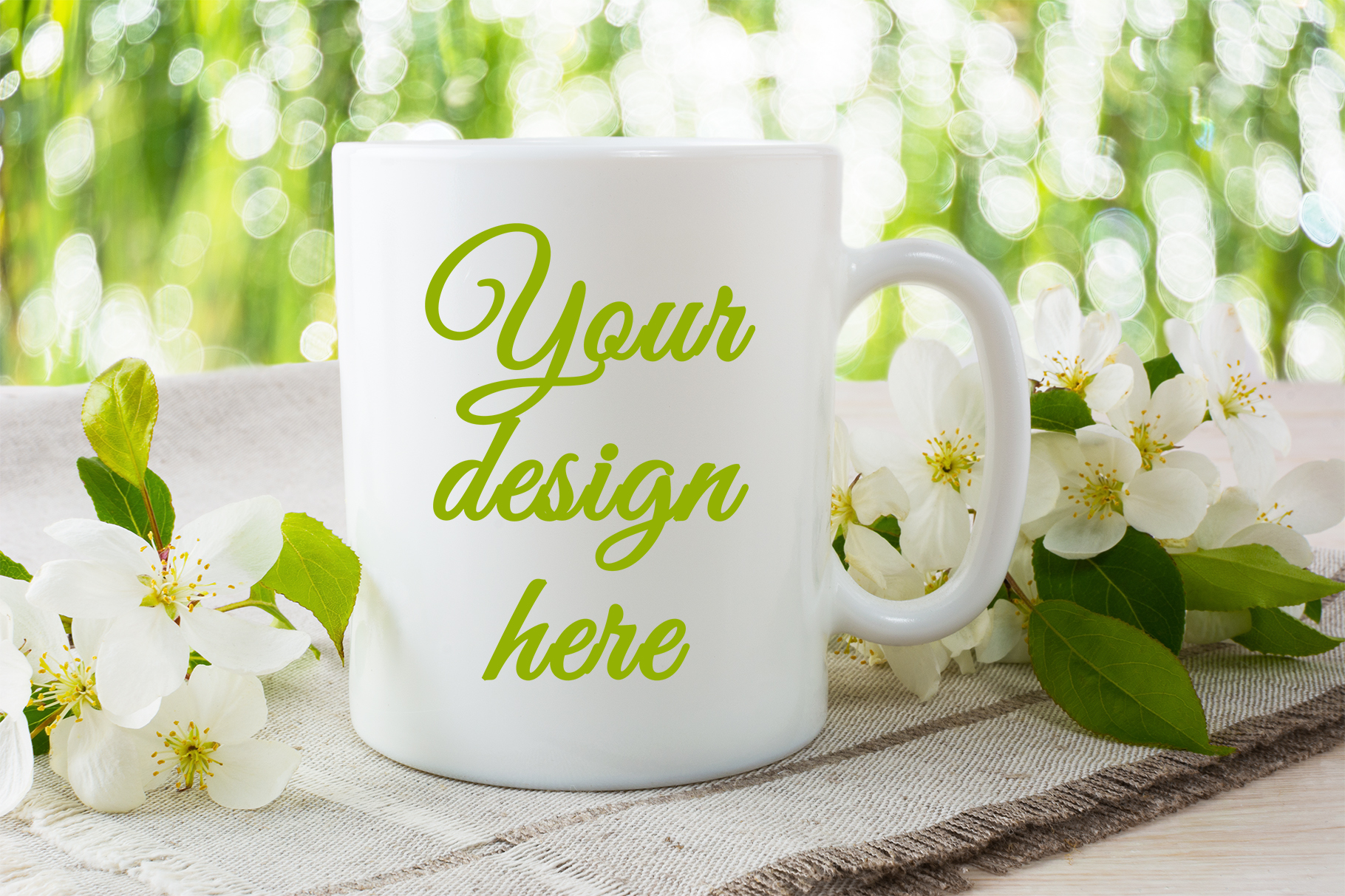 Print on Demand: Mug Mockup with Apple Blossom Grafik Produktmodelle von TasiPas