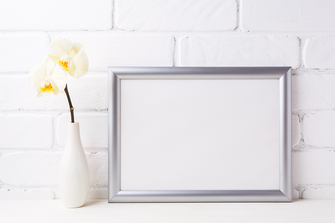 Print on Demand: Silver Landscape Frame Mockup with Soft Yellow Orchid in Vase Graphic Product Mockups By TasiPas - Image 2
