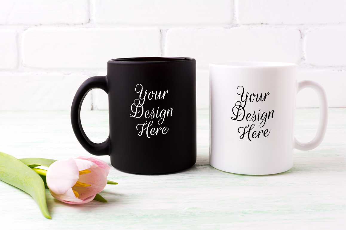 Print on Demand: White and Black Mug Mockup with  Pink Tulip. Graphic Product Mockups By TasiPas