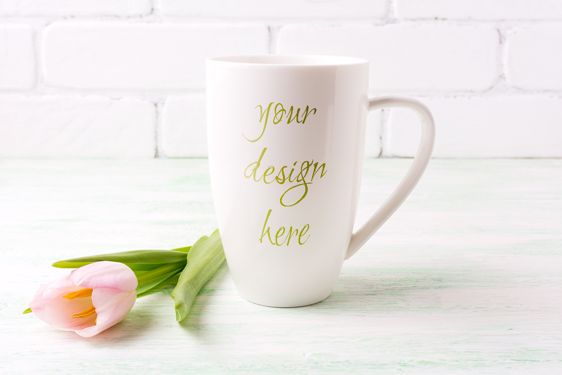 Download Free White Coffee Cappuccino Mug Mockup With Pink Tulip Graphic By for Cricut Explore, Silhouette and other cutting machines.