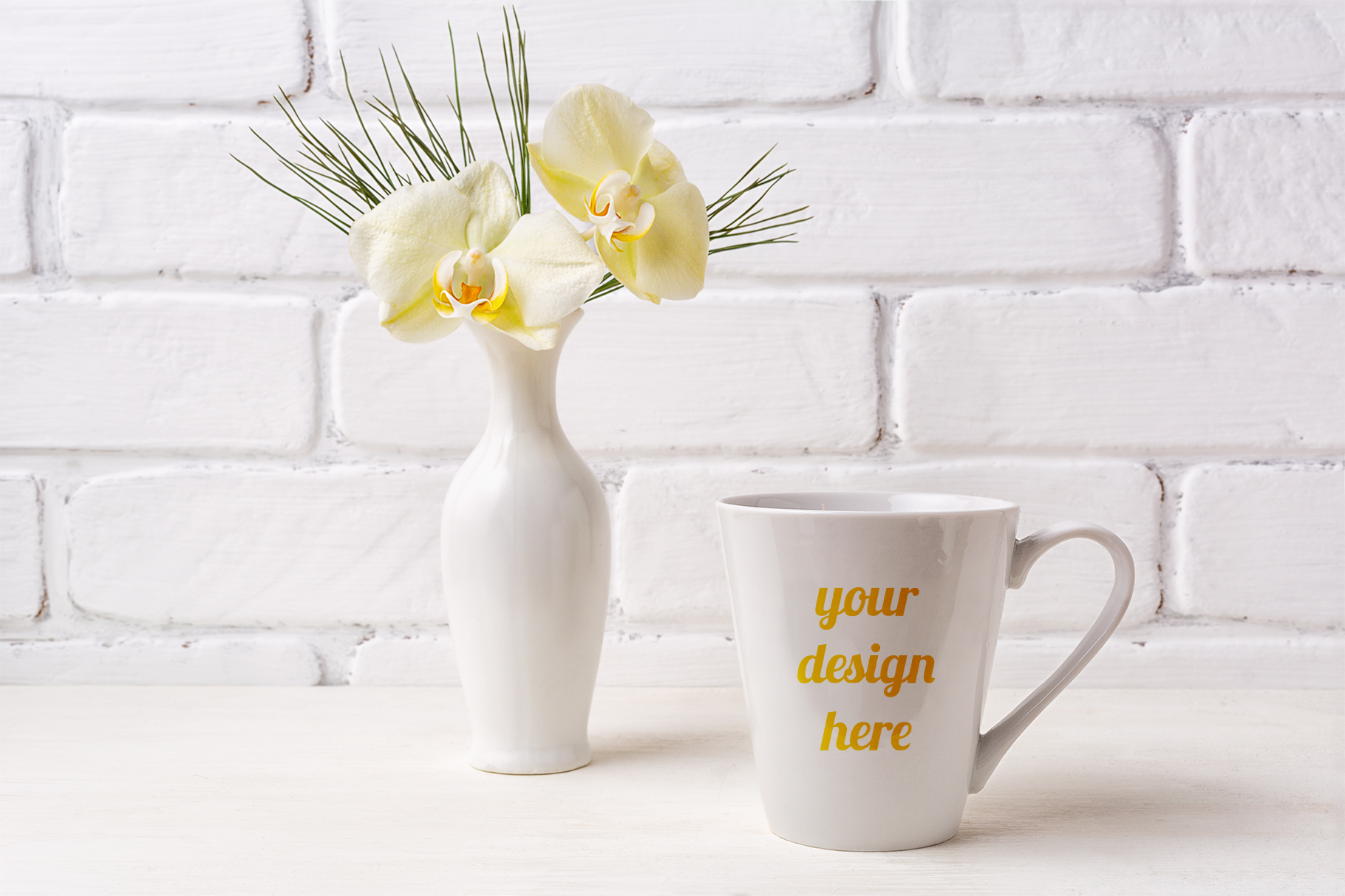 Print on Demand: White Coffee Latte Mug Mockup with Soft Yellow Orchid in Vase Graphic Product Mockups By TasiPas