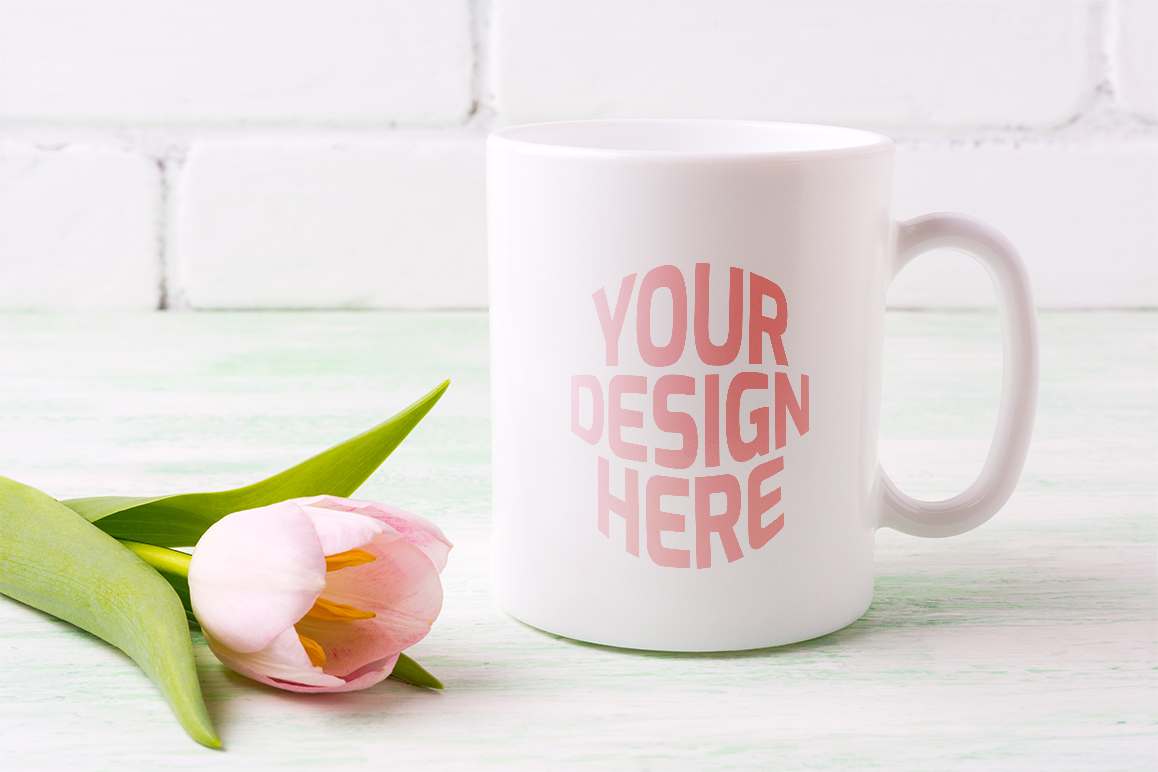 Print on Demand: White Coffee Mug Mockup with  Pink Tulip. Graphic Product Mockups By TasiPas