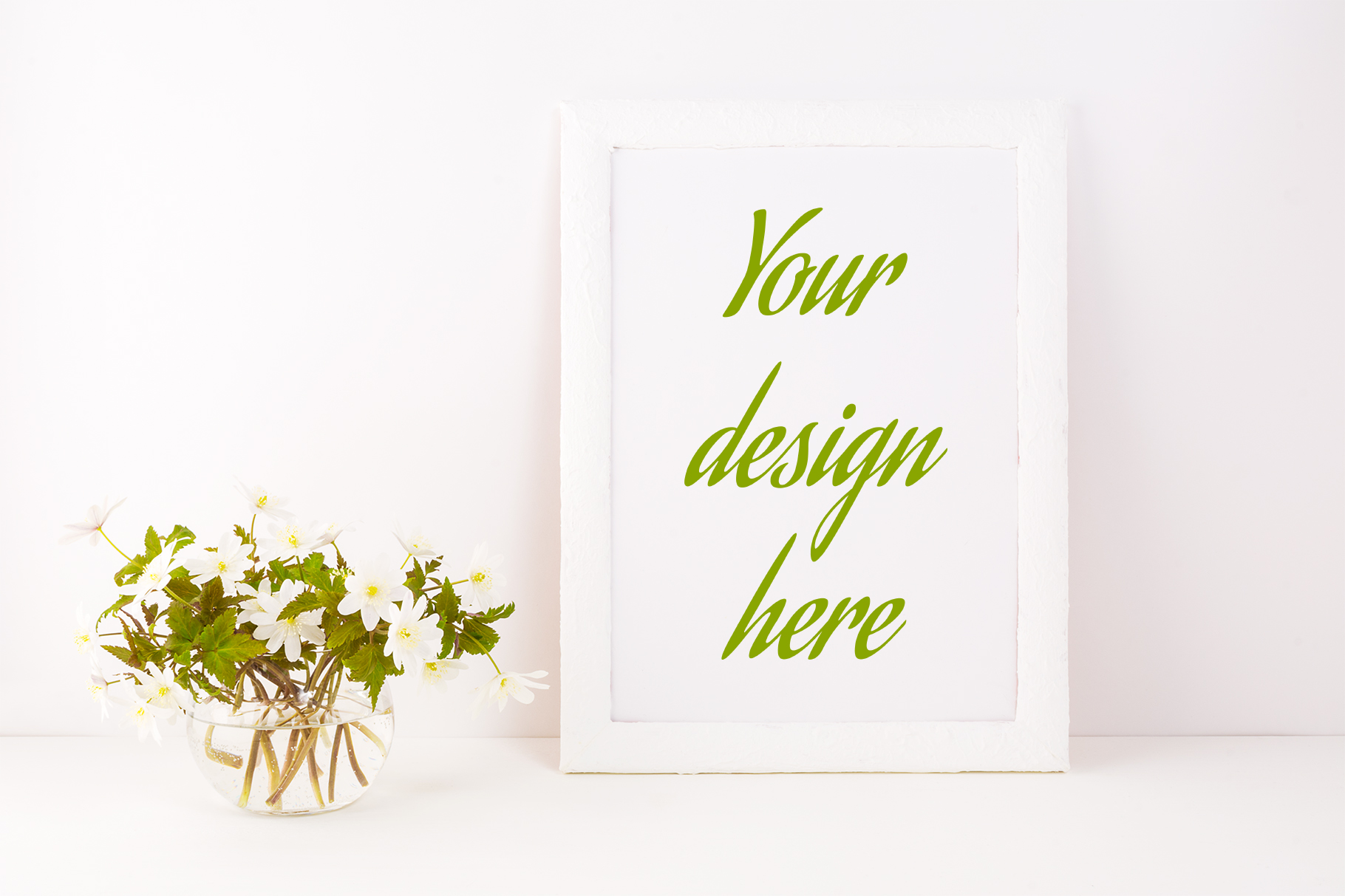 Print on Demand: White Frame Mockup with Rue Anemone Flowers Graphic Product Mockups By TasiPas