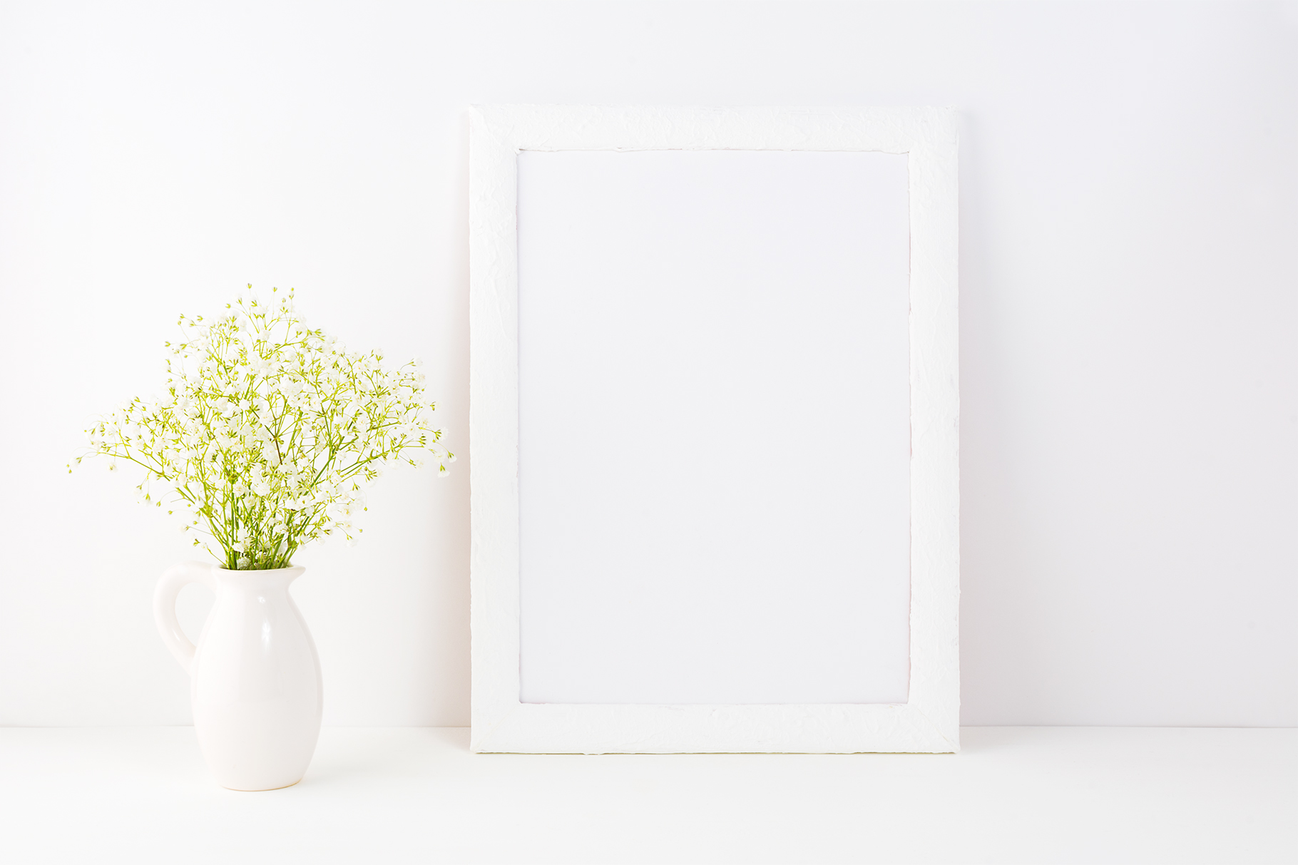 Download Free White Frame Mockup With Baby S Breath Flowers Grafico Por for Cricut Explore, Silhouette and other cutting machines.