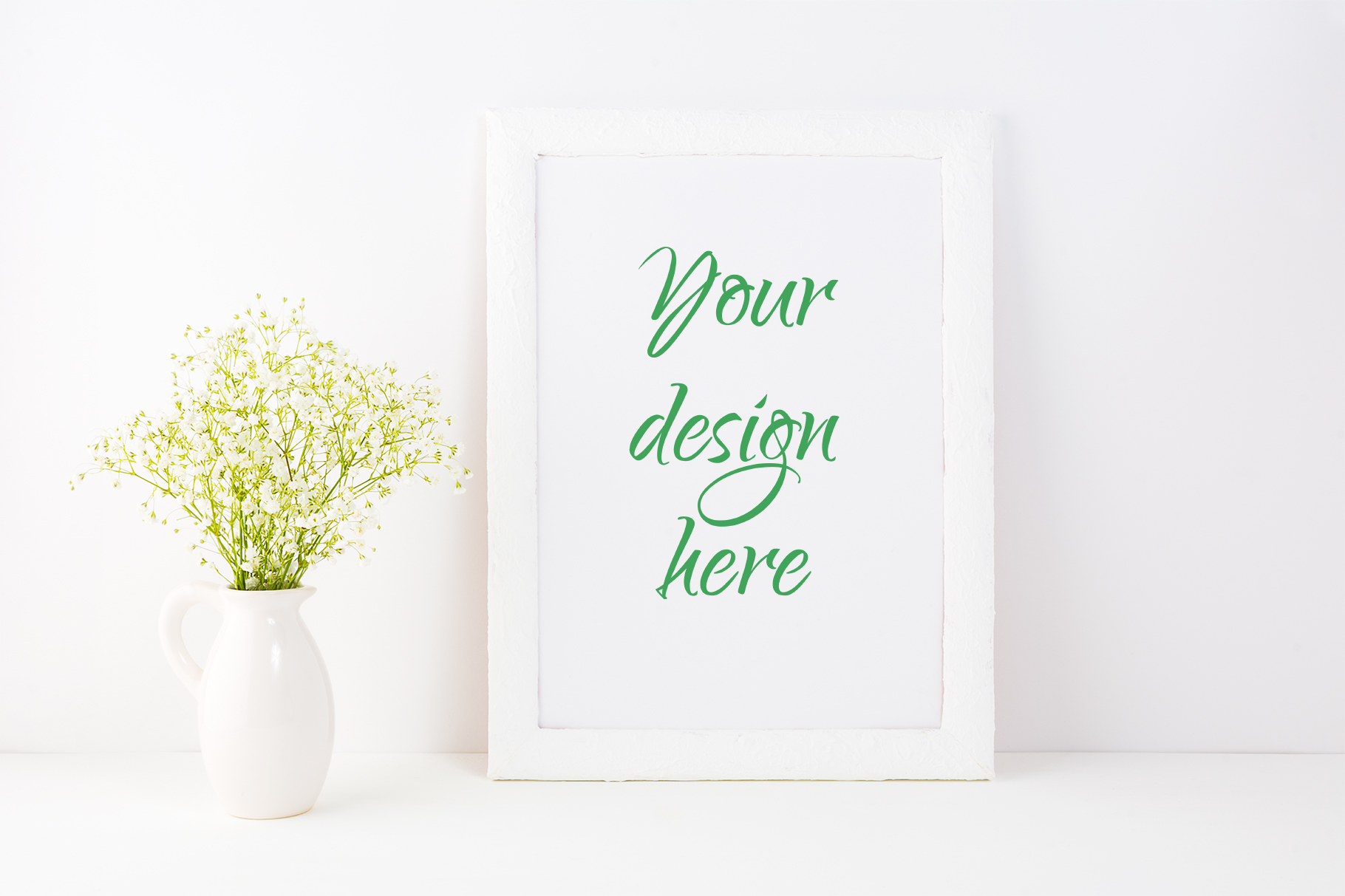 Print on Demand: White Frame Mockup with Baby's Breath Flowers Graphic Product Mockups By TasiPas