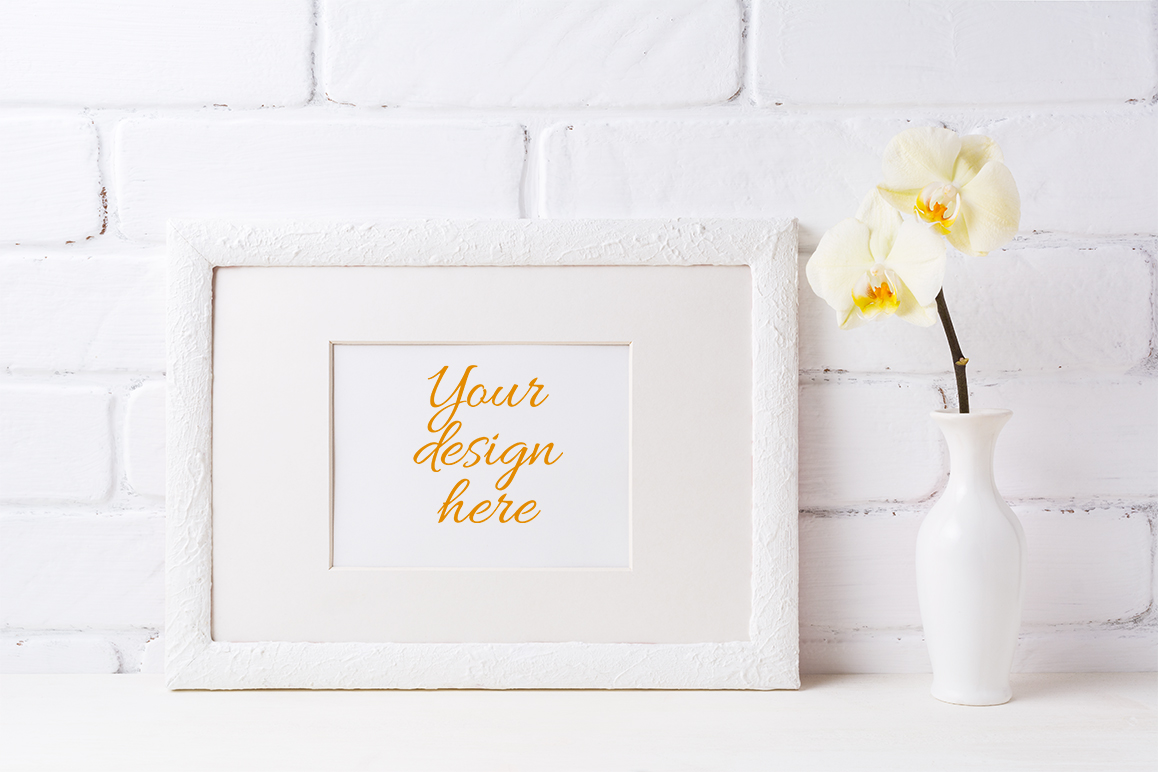 Print on Demand: White Frame Mockup with Soft Yellow Orchid in Vase Graphic Product Mockups By TasiPas