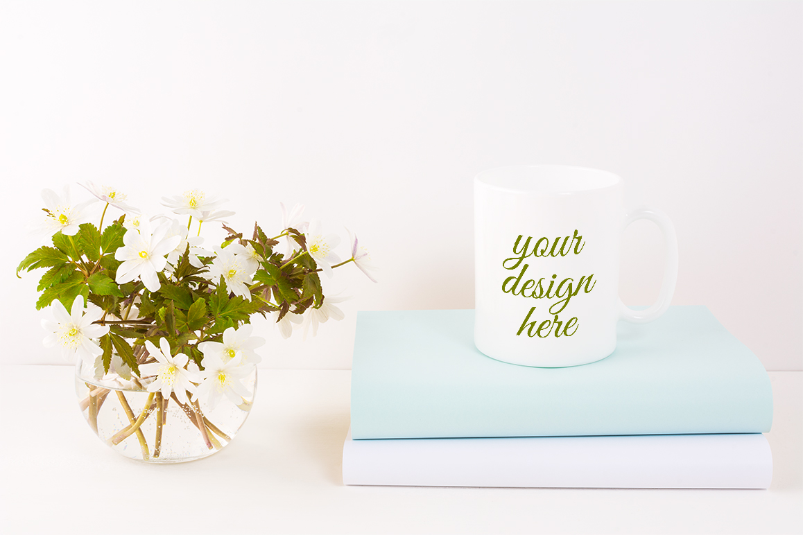 Print on Demand: White Mug Mockup with Rue Anemone Flowers Graphic Product Mockups By TasiPas