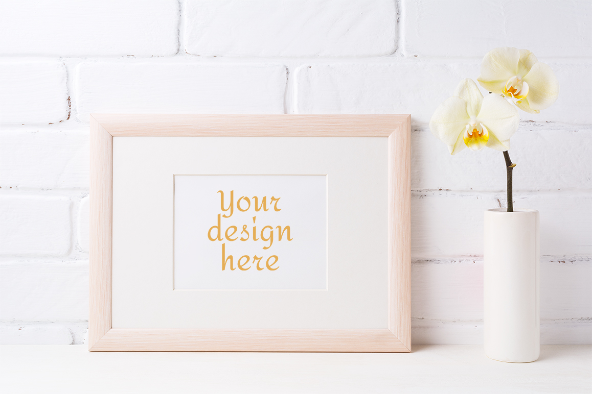 Print on Demand: Wooden Landscape Frame Mockup with Soft Yellow Orchid in Vase Graphic Product Mockups By TasiPas