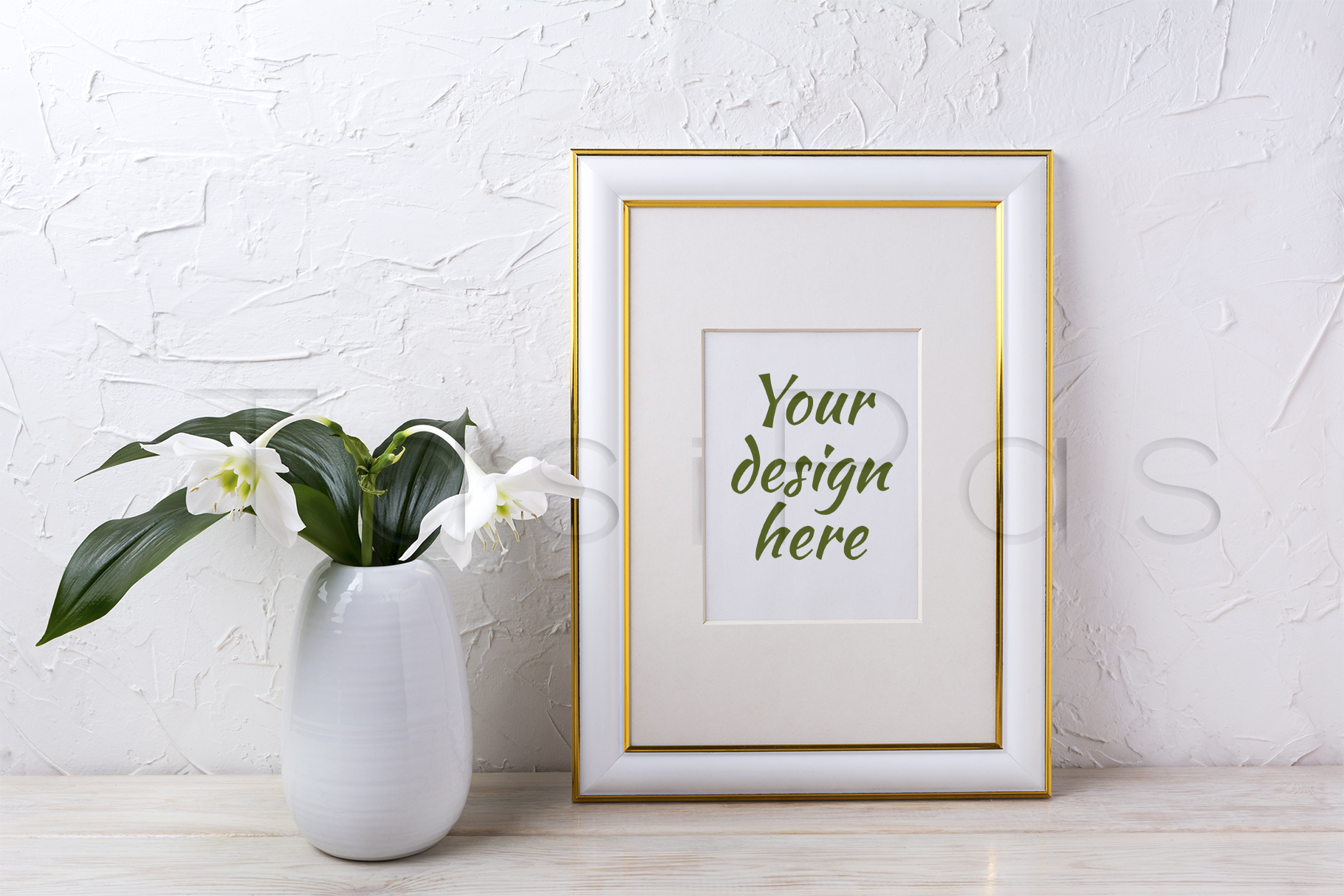 Print on Demand: Gold Decorated Frame Mockup with Tender White Lily in Vase Grafik Produktmodelle von TasiPas