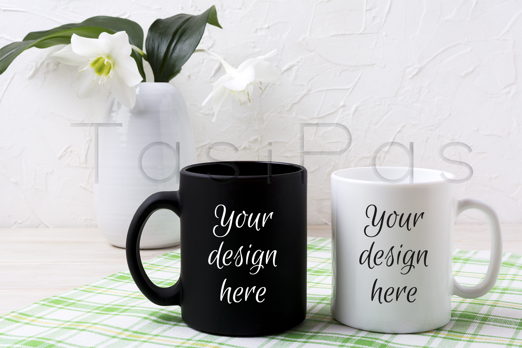 Print on Demand: White and Black Mug Mockup with Lily in Vase Graphic Product Mockups By TasiPas
