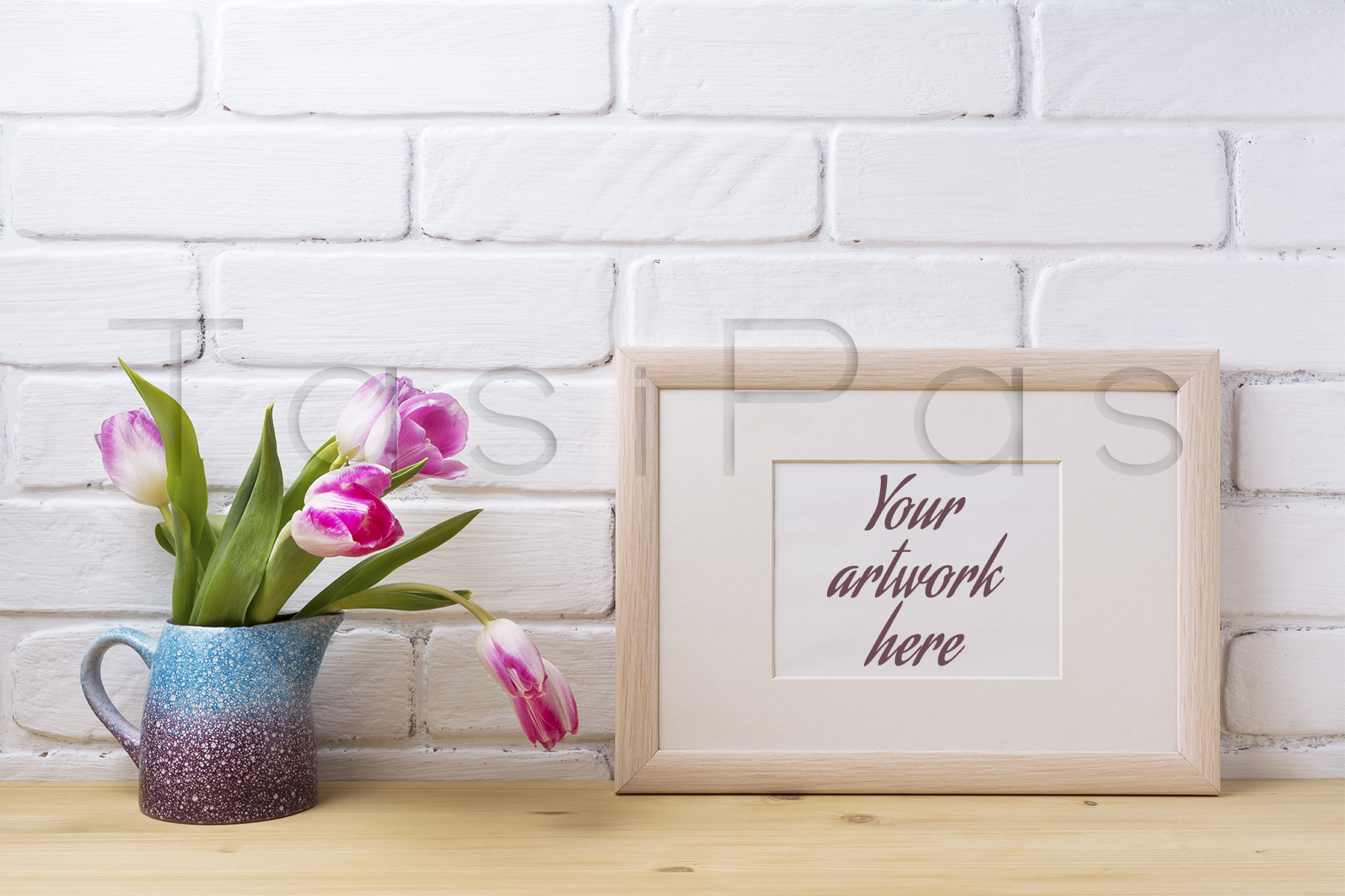 Print on Demand: Wooden Landscape Frame Mockup with Pink Tulip in Purple Pitcher. Graphic Product Mockups By TasiPas