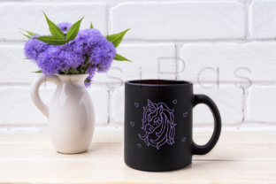 Print on Demand: Black Coffee Mug Mockup with Blue Ageratum in Pitcher Graphic Product Mockups By TasiPas