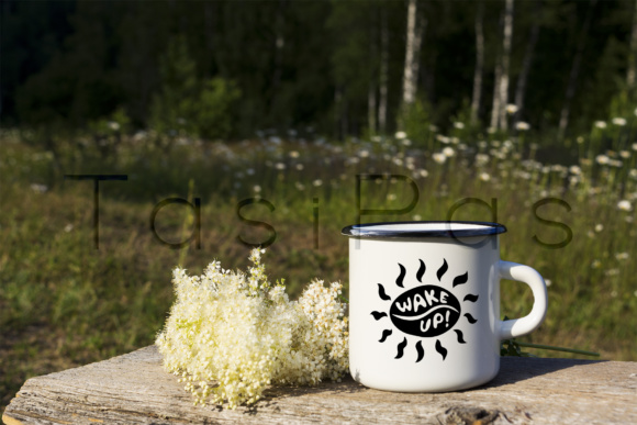 Print on Demand: White Campfire Enamel Mug Mockup with White Flowers. Graphic Product Mockups By TasiPas