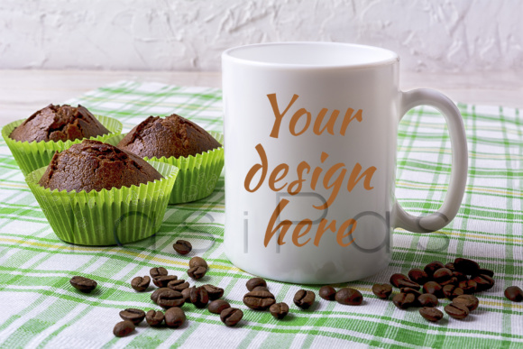 Print on Demand: White Mug Mockup with Chocolate Muffins on Green Checkered Napkin Graphic Product Mockups By TasiPas