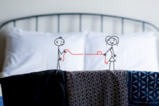 A Stickman Boy Holding on to a Red Thread on One Pillow. on the Other Pillow, a Stick Girl Holding the Other End of the Tread, Where It Forms a Heart Love Craft Cut File By Creative Fabrica Crafts
