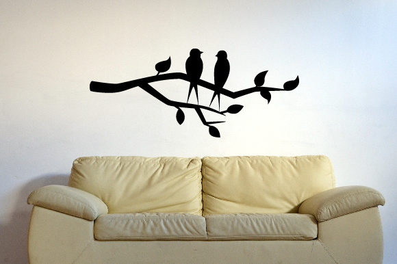 A Tree Branch with Leaves and a Couple of Birds on It Silhouette Wall Art Plotterdatei von Creative Fabrica Crafts
