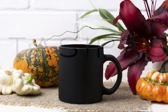 Black Coffee Mug Mockup with Pumpkin and Red Lily Graphic By TasiPas Image 2