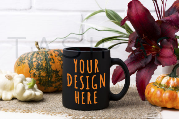 Black Coffee Mug Mockup with Pumpkin and Red Lily Graphic By TasiPas Image 1