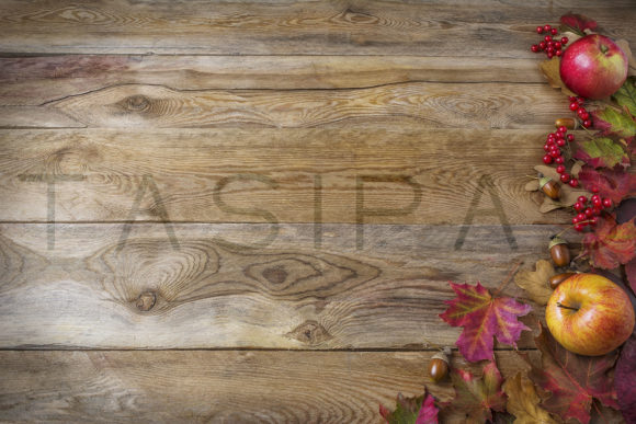 Thanksgiving Background with Apples, Acorns, Berries and Fall Leaves on the Old Wooden Background Graphic By TasiPas