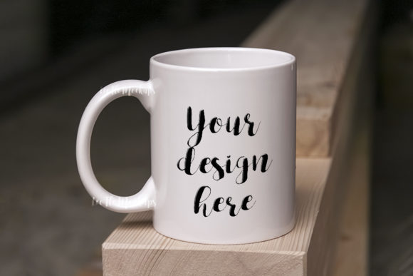 Print on Demand: White Coffee Mug Mock Up on Wood Graphic Product Mockups By Leo Flo Mockups