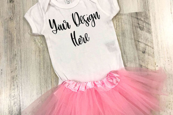 Print on Demand: White Baby Bodysuit with Tutu Mockup Photo Graphic Product Mockups By boecustomdesign