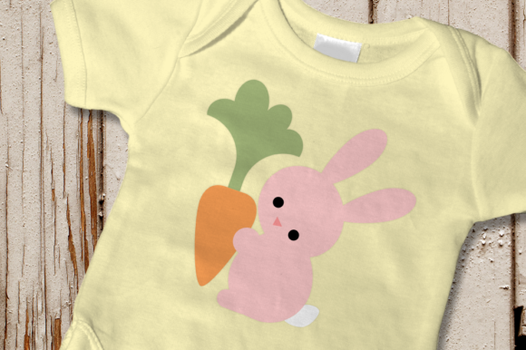 Download Free Easter Bunny Holding Carrot Graphic By Designedbygeeks for Cricut Explore, Silhouette and other cutting machines.