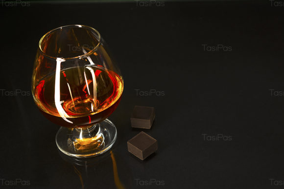 Print on Demand: Brandy Glass and Chocolate on Black Graphic Food & Drinks By TasiPas