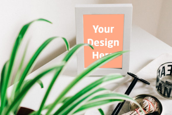 Print on Demand: Frame on Table with Branches Graphic Product Mockups By Outflow Designs