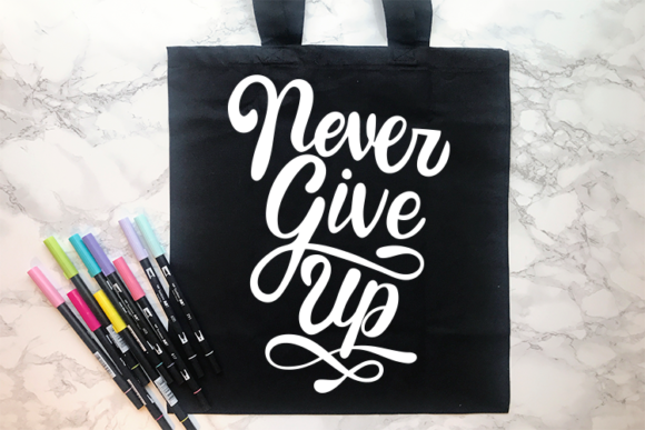 Download Free Never Give Up Svg Graphic By Carrtoonz Creative Fabrica for Cricut Explore, Silhouette and other cutting machines.
