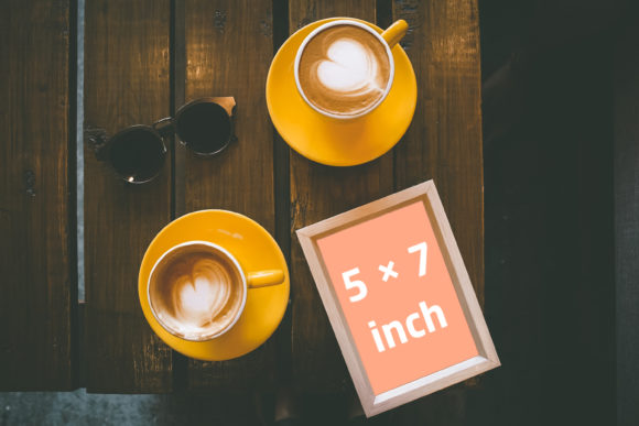 Print on Demand: Wooden Frame with 2 Orange Coffee Cups Graphic Product Mockups By Outflow Designs
