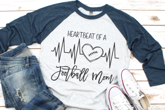 Download Free Heartbeat Of A Football Mom Graphic By Morgan Day Designs for Cricut Explore, Silhouette and other cutting machines.