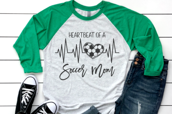 Download Free Heartbeat Of A Soccer Mom Graphic By Morgan Day Designs for Cricut Explore, Silhouette and other cutting machines.