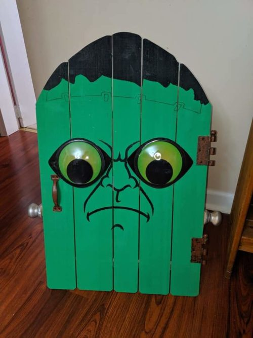 Download Free Halloween Decoration Craft A Frankenstein Door Creative Fabrica for Cricut Explore, Silhouette and other cutting machines.