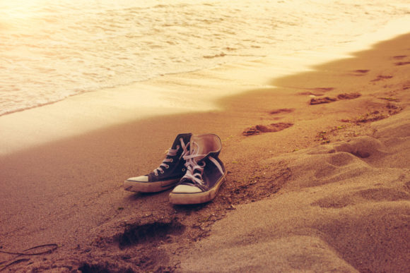 Hipster Sneakers in a Sea Surf on a Sand Graphic Beauty & Fashion By fleurartmariia - Image 1