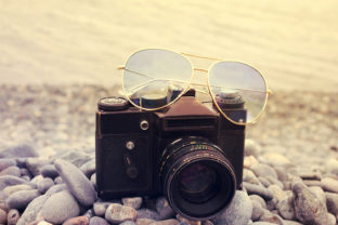 Old Camera with Sun Glasses Close Up Graphic By fleurartmariia