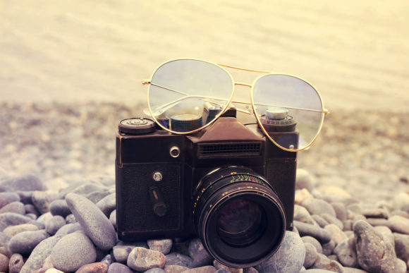 Old Camera with Sun Glasses Close Up Graphic Beauty & Fashion By fleurartmariia - Image 1