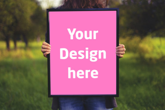 Print on Demand: Frame Hold by Woman in Garden Graphic Product Mockups By Outflow Designs