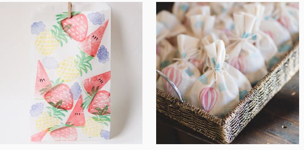cream linen gift bags with colourful fruit designs