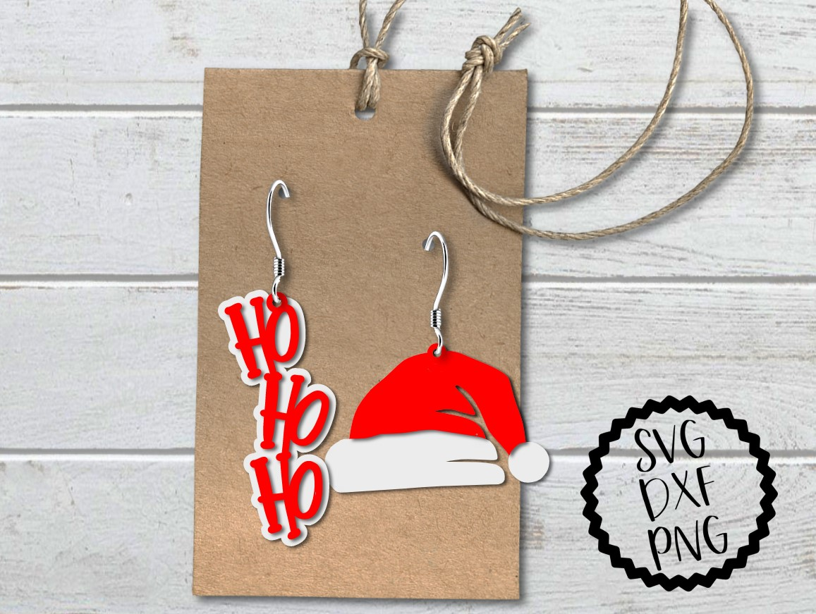 Download Free Santa Hat And Ho Ho Ho Earrings Svg Graphic By Printsofpop for Cricut Explore, Silhouette and other cutting machines.