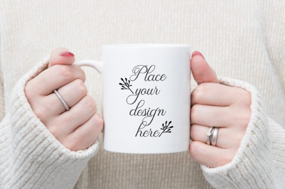 Print on Demand: Girl Holding Mug Mockup Winter Graphic Product Mockups By Leo Flo Mockups