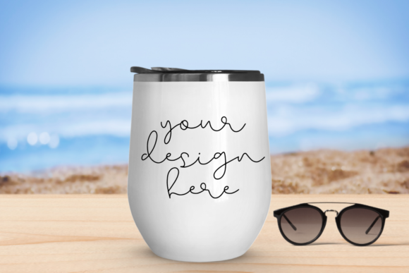 Print on Demand: White Tumbler Mock Up with Beach Background Graphic Product Mockups By Mockup Venue