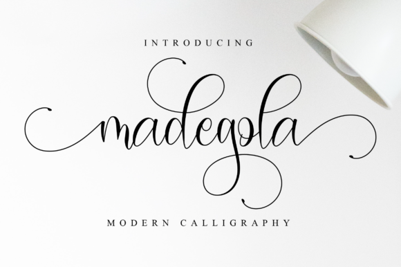 Print on Demand: Madegola Script Script & Handwritten Font By NissaStudio