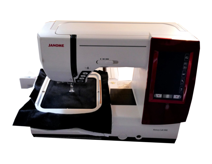 white janome embroidery machine with embroidery hoop